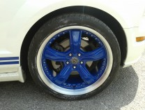 Blue split rims on a Ford Mustang GT